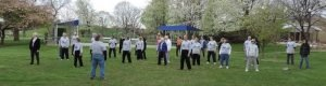 Students perform qigong exercises at the Kettering Rec Center